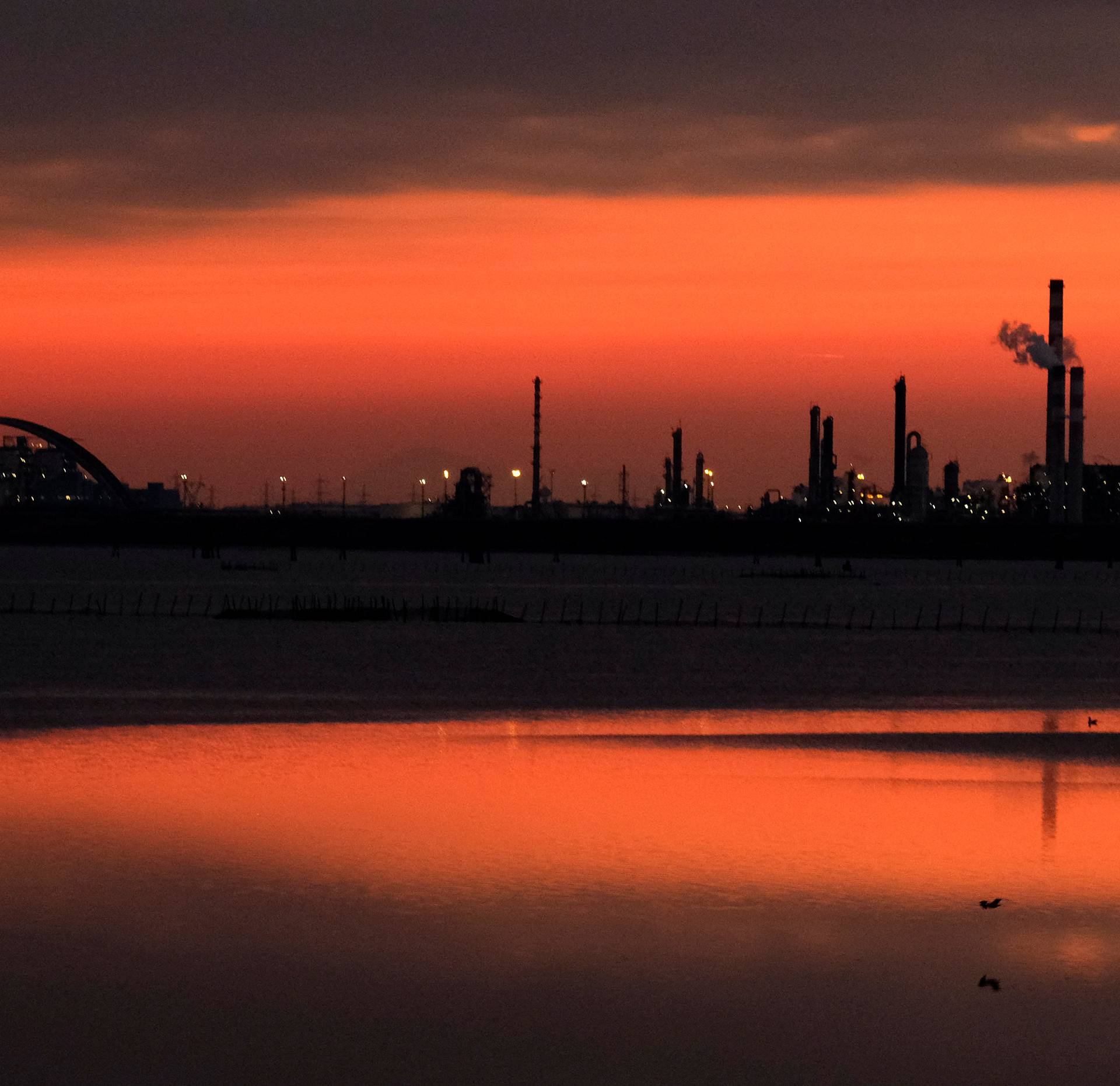 Docks are seen at sunset at the Industrial port of Marghera in the lagoon of Venice