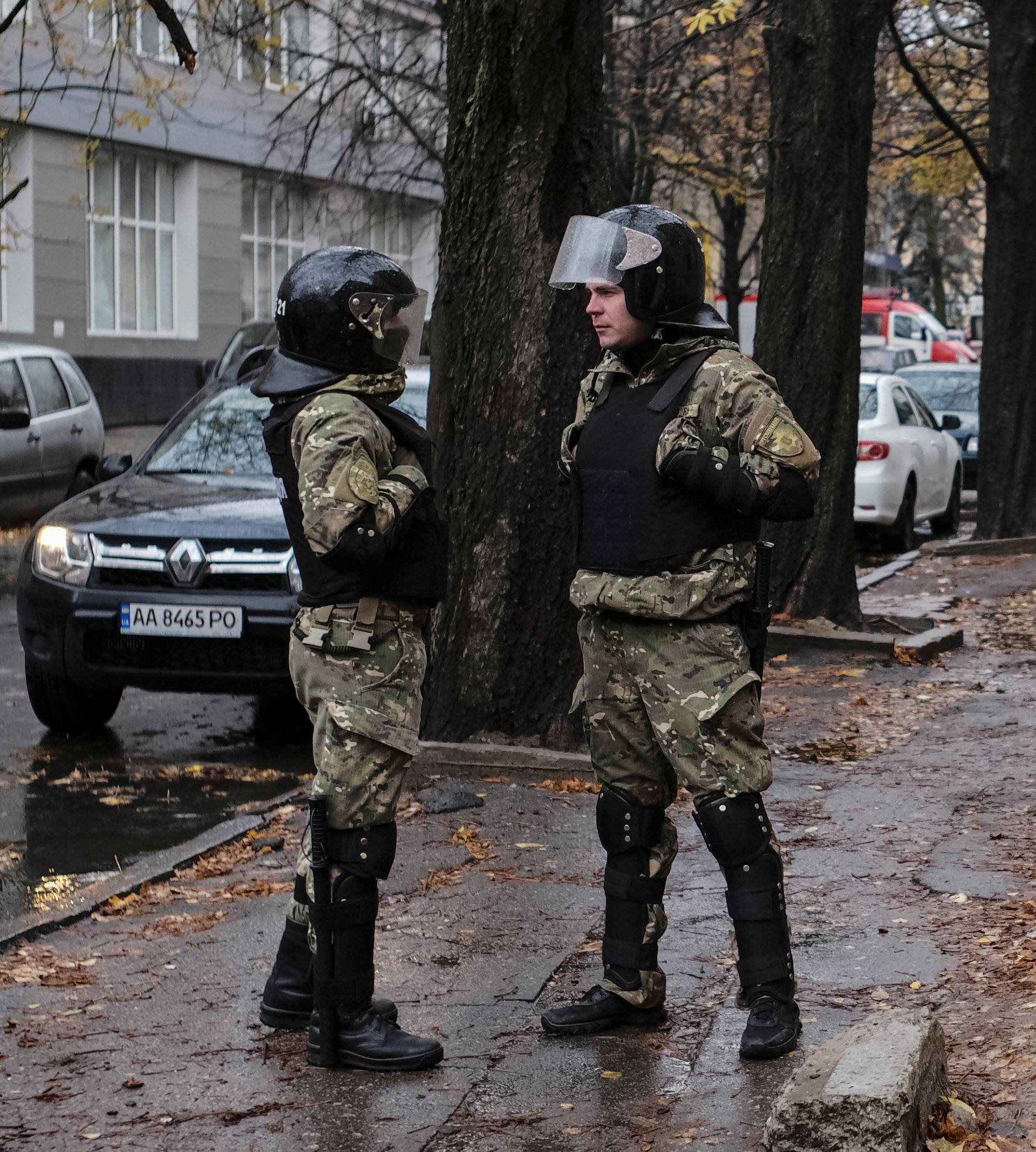 A special police unit stands guard near the apartment of Ukrainian Interior Minister Avakov's son,  Oleksandr, who was detained today, local media reported, in Kharkiv