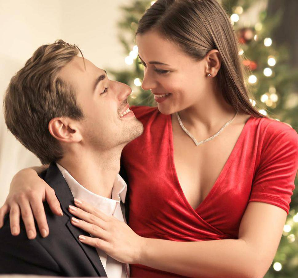 Passionate couple celebrating New Year's Eve together at home