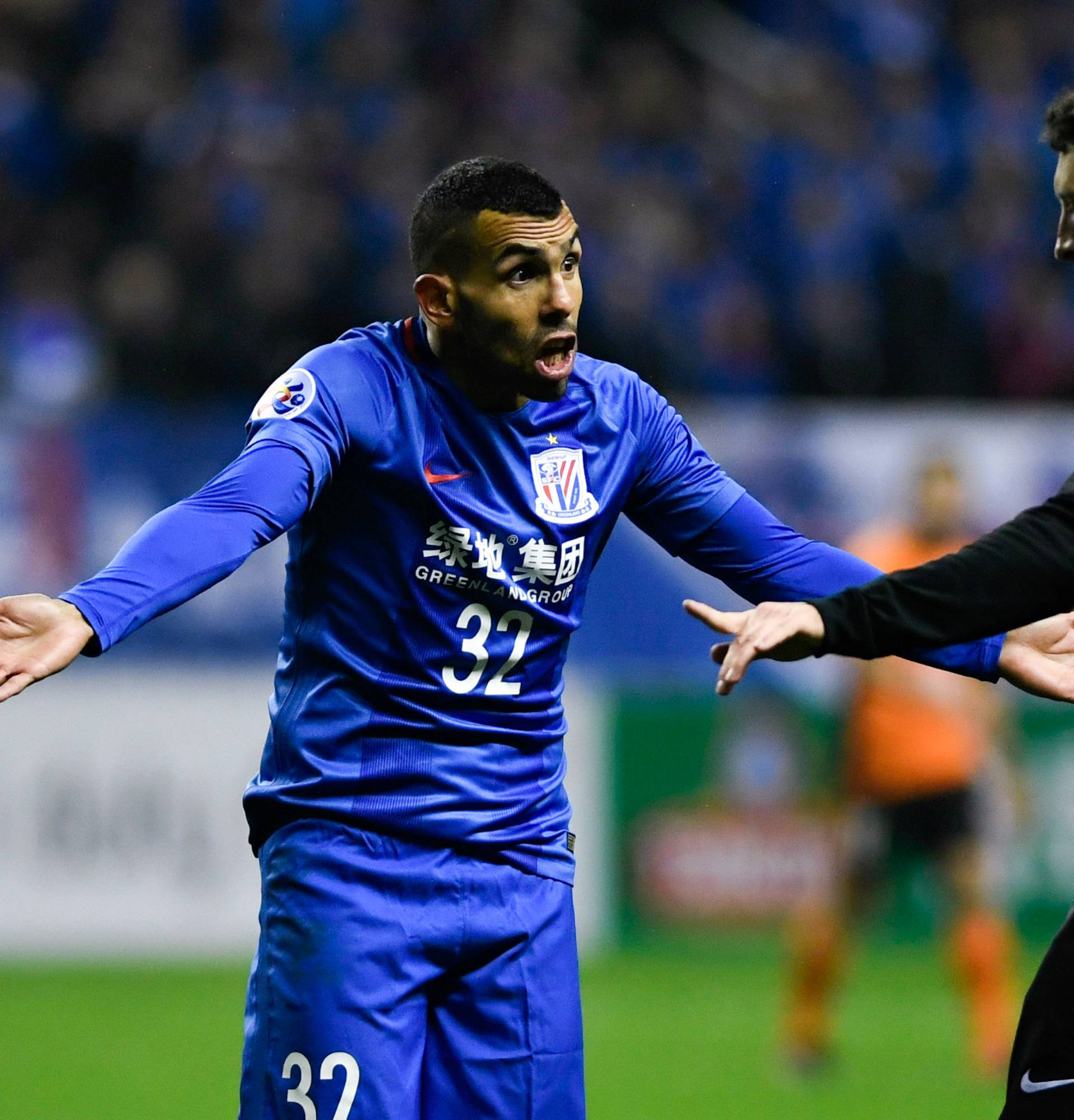 Shanghai Shenhua's Carlos Tevez reacts to a referee during the AFC Champions League 2017 play-off match between Shanghai Shenhua and Brisbane Roar in Shanghai