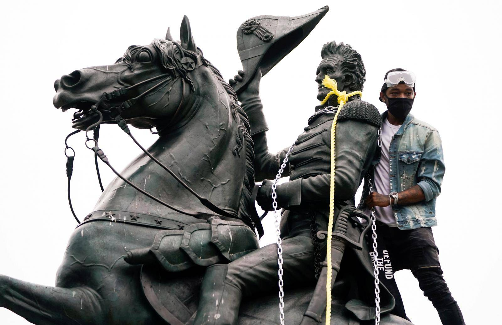 Protestors try to pull down statue of U.S. President Andrew Jackson in front of the White House in Washington