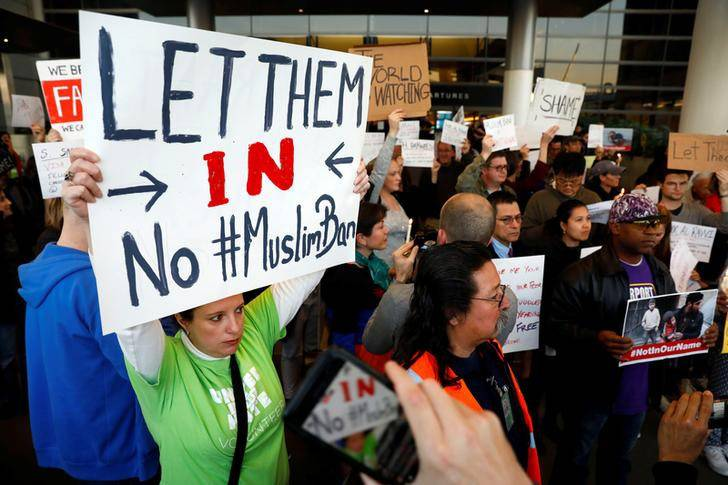 People protest Donald Trump's travel ban from Muslim majority countries at the International terminal at Los Angeles International Airport (LAX) in Los Angeles, California