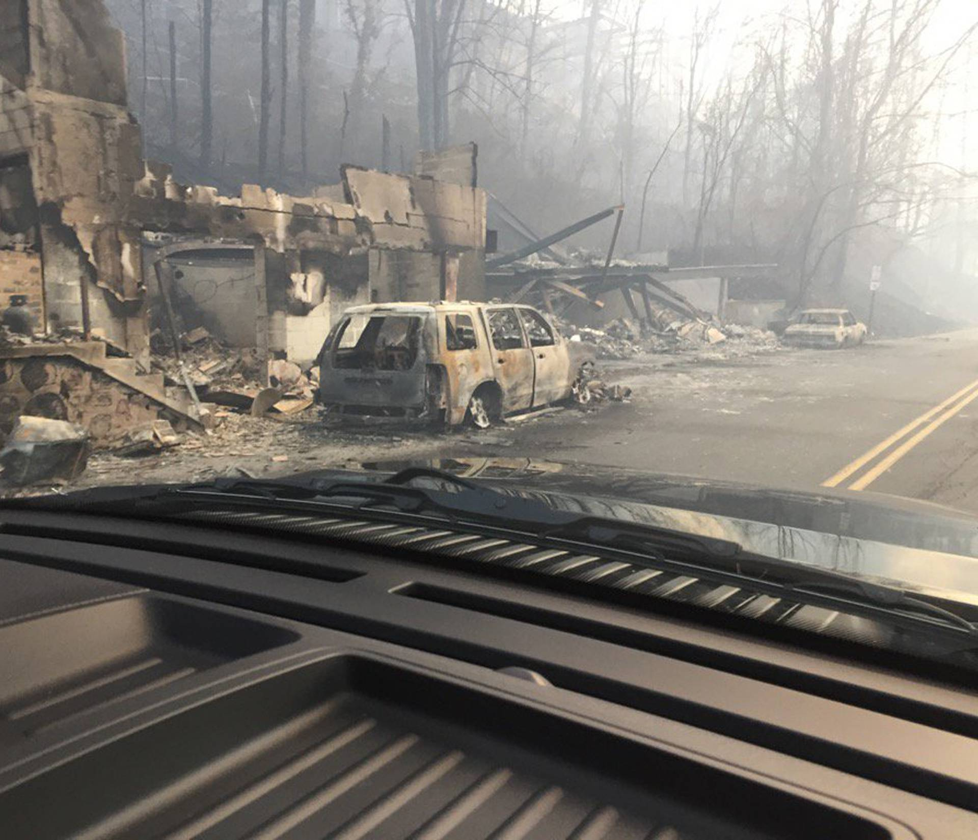 Burned buildings and cars aftermath of wildfire in Gatlinburg Tennessee