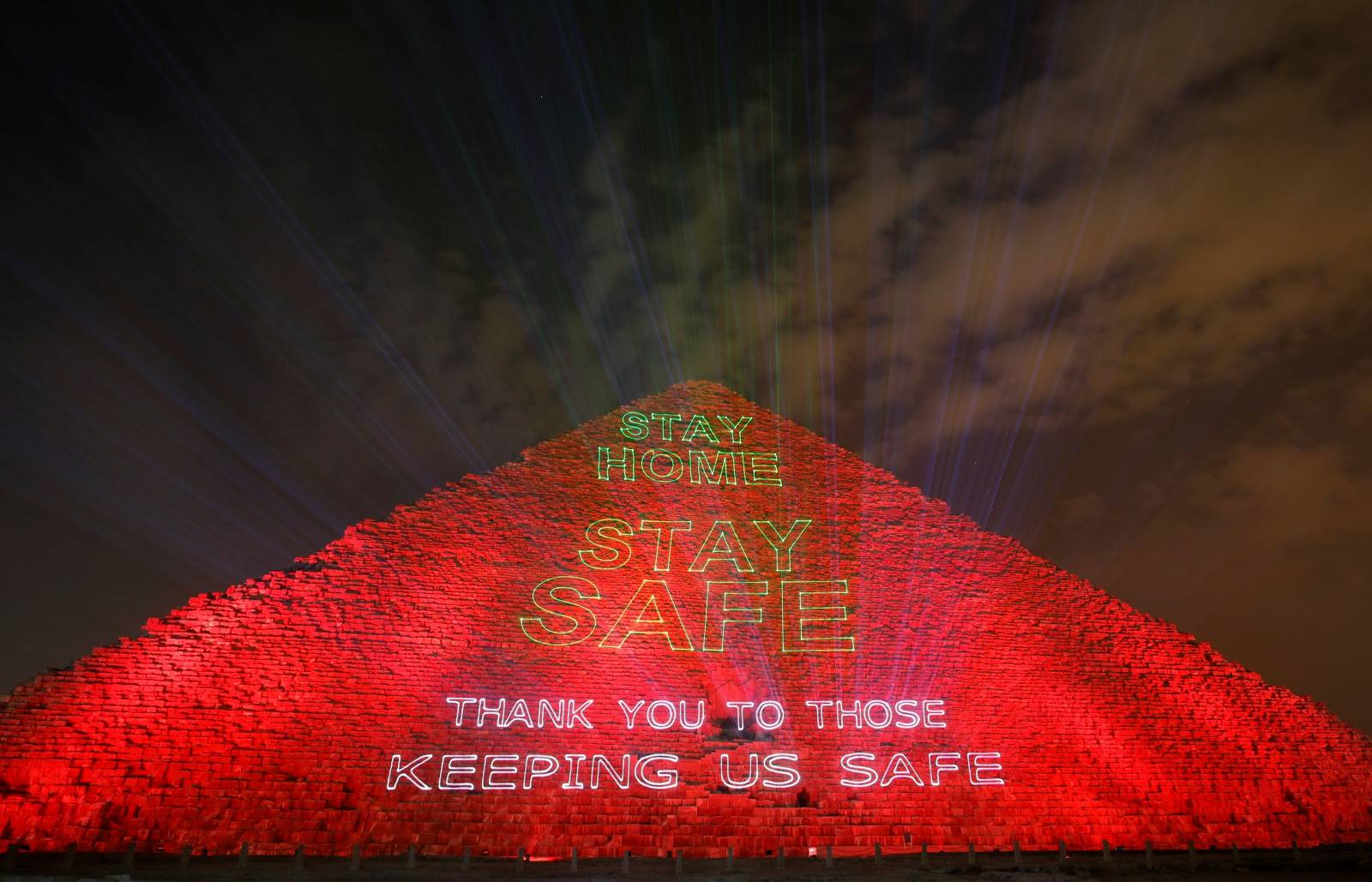 The pyramid of Khufu, the largest?of the?Giza pyramid complex,?is?illuminated with text encouraging?to stay home, in Giza