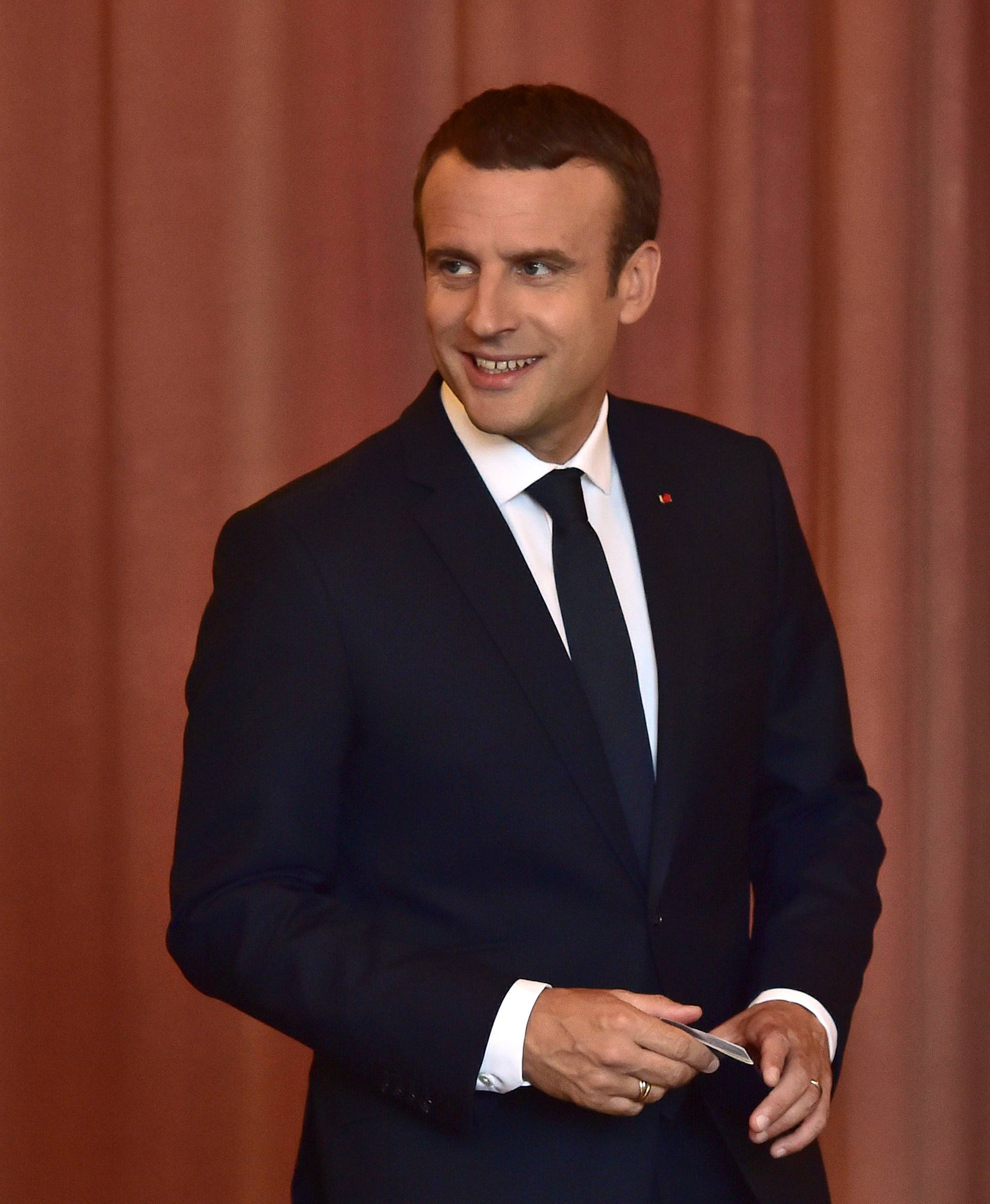 French President Emmanuel Macron arrives to vote at a polling station in the second round parliamentary elections in Le Touquet