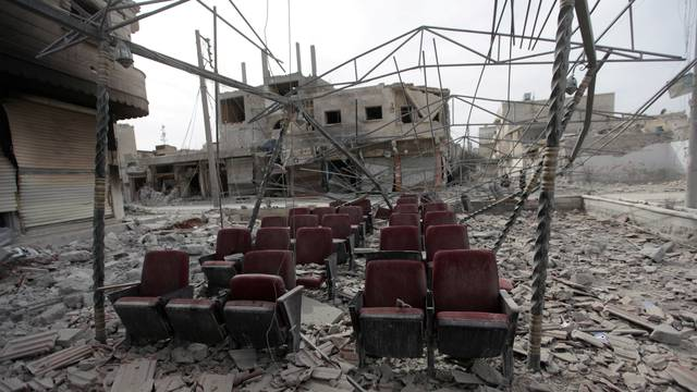 Damaged seats are pictured amidst rubble of buildings in the northern Syrian town of al-Bab