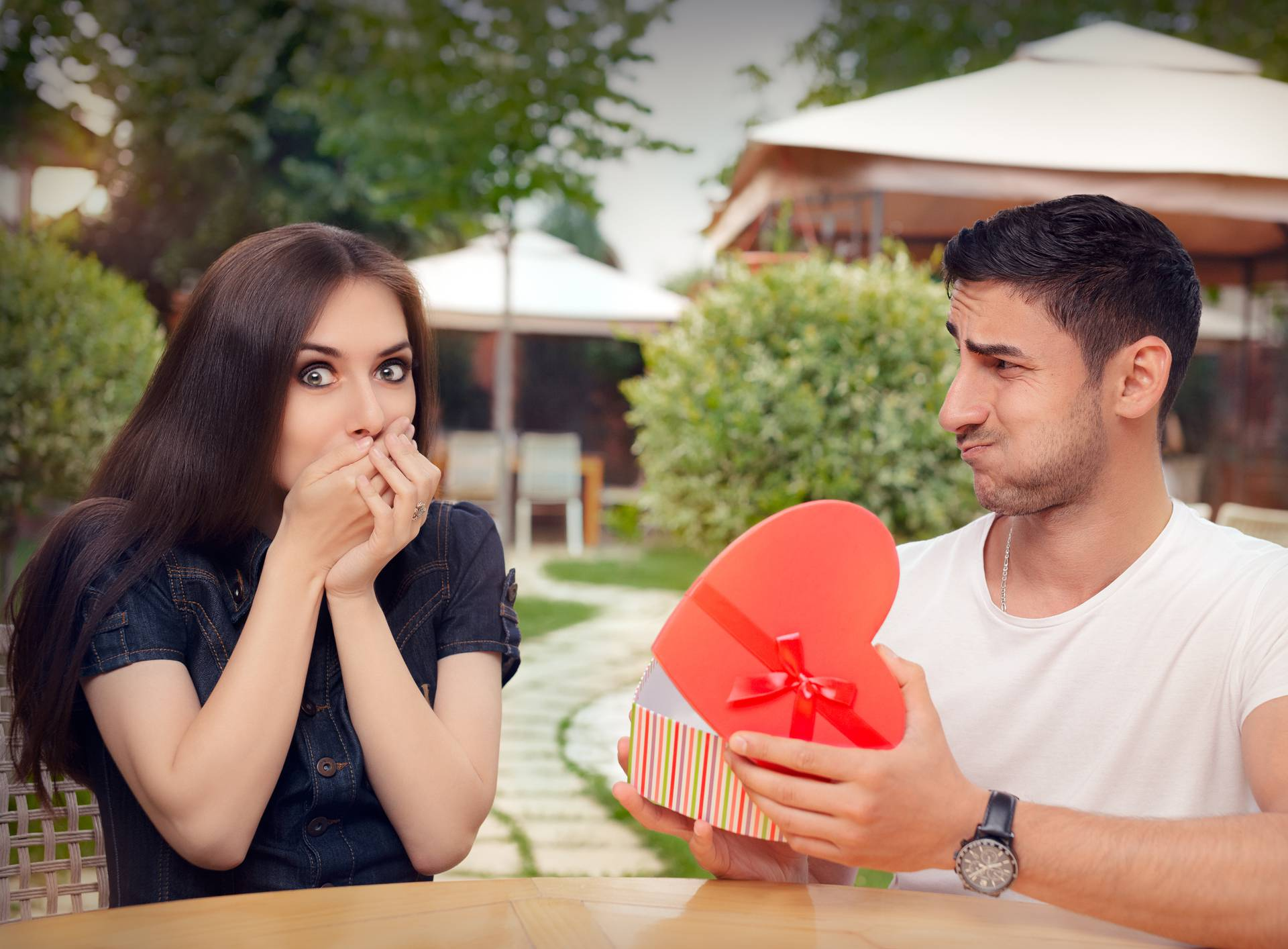 Happy Girl Receiving Heart Shaped Gift from her Boyfriend