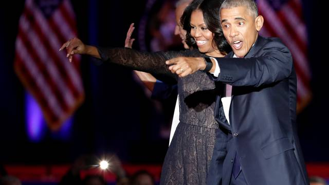 U.S. President Barack Obama and his wife Michelle acknowledge the crowd after President Obama delivered a farewell address at McCormick Place in Chicago