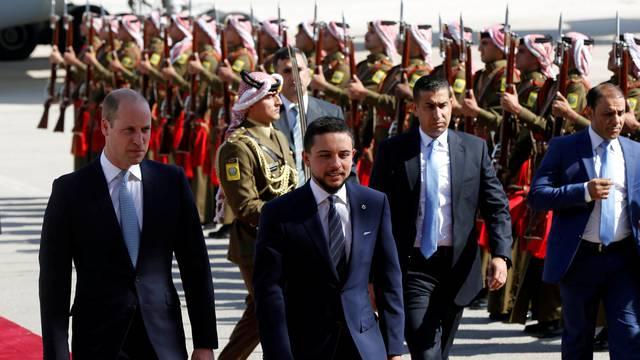 Britain's Prince William and Jordan's Crown Prince Hussein bin Abdullah II review the honour guard in Amman