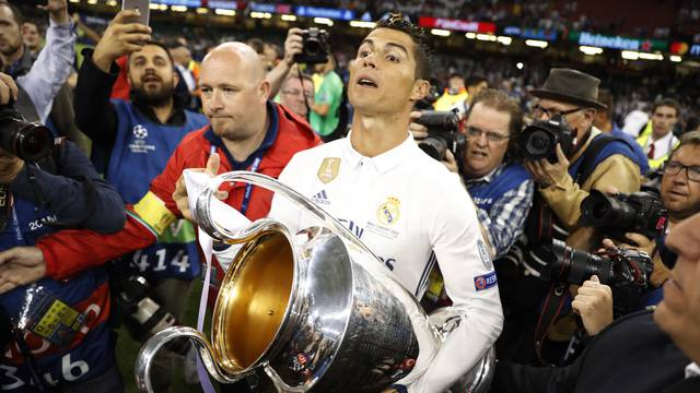 Real Madrid's Cristiano Ronaldo celebrates with the trophy after winning the UEFA Champions League Final