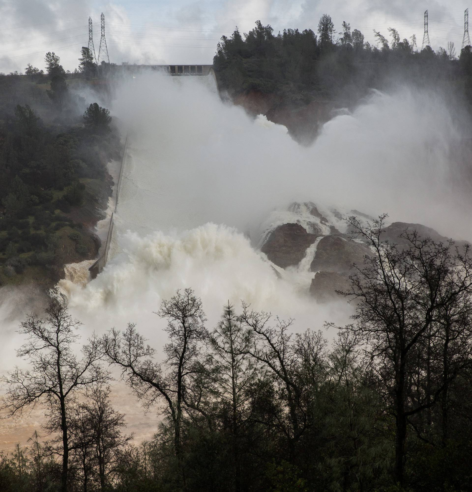 65,000 cfs of water flows through a damaged spillway on the Oroville Dam in Oroville, California