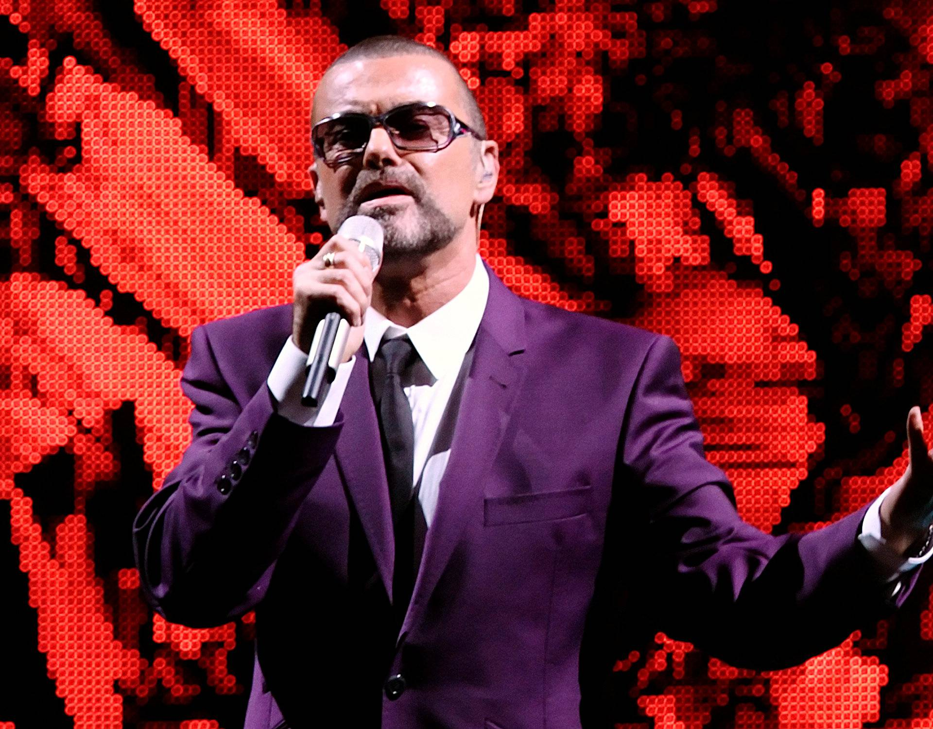 """FILE PHOTO British singer George Michael performs on stage during his """"Symphonica"""" tour concert in Vienna"""