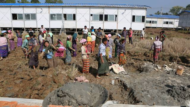 People work inside a camp set up by Myanmar's Social Welfare, Relief and Resettlement Minister to prepare for the repatriation of displaced Rohingyas, who fled to Bangladesh, outside Maungdaw in the state of Rakhine