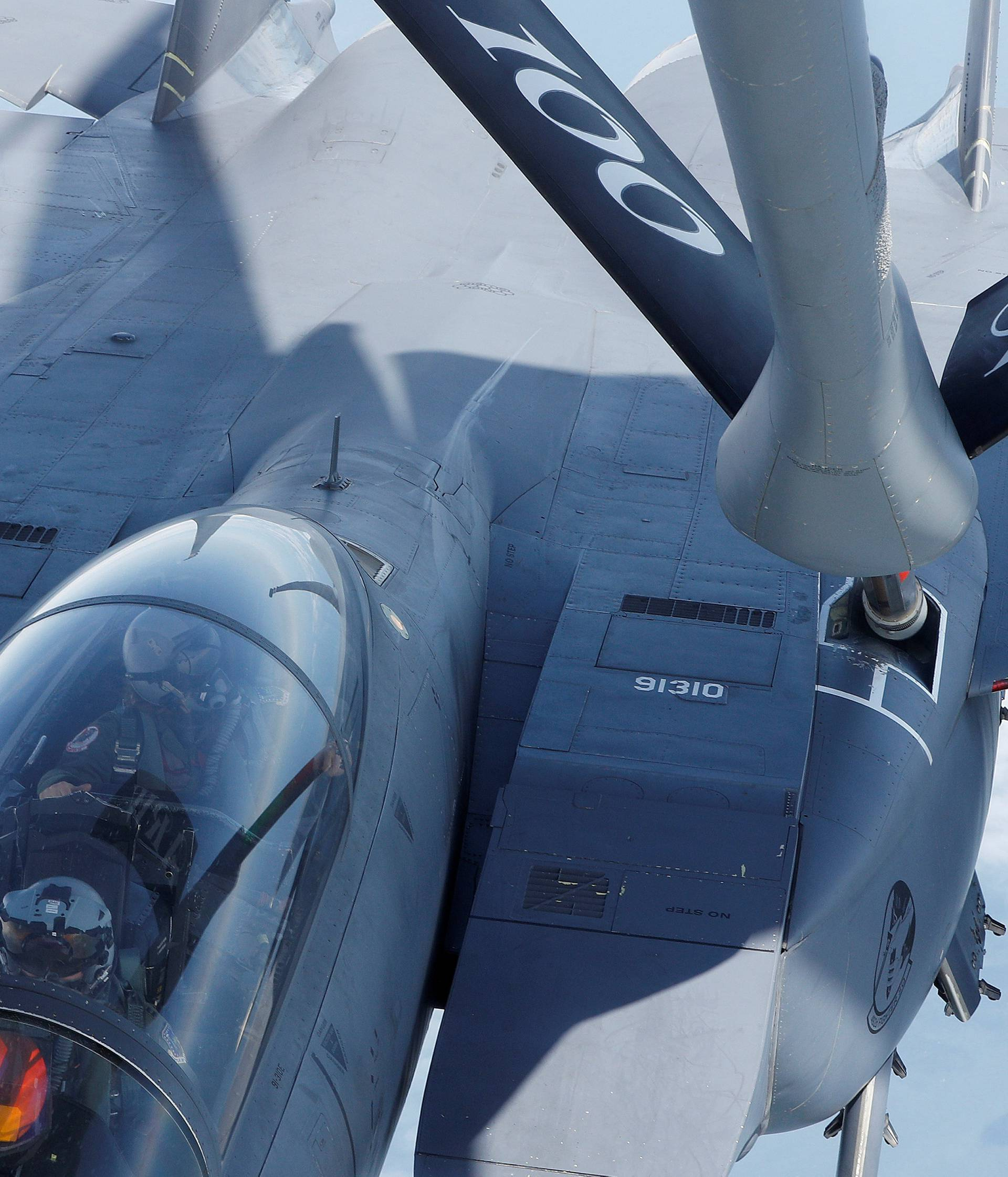 A F15 is refuelled by a U.S Air Force KC-135 during a European Tanker Symposium from RAF Mildenhall