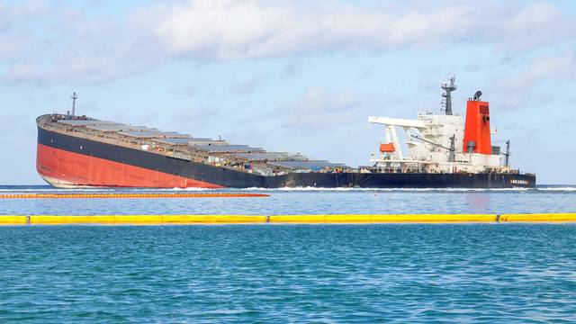 The bulk carrier ship MV Wakashio that ran aground on a reef, at Riviere des Creoles