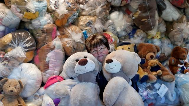"""Valeria Schmidt, nicknamed as """"Teddy Bear Mama"""", hugs teddy bears in Harsany"""
