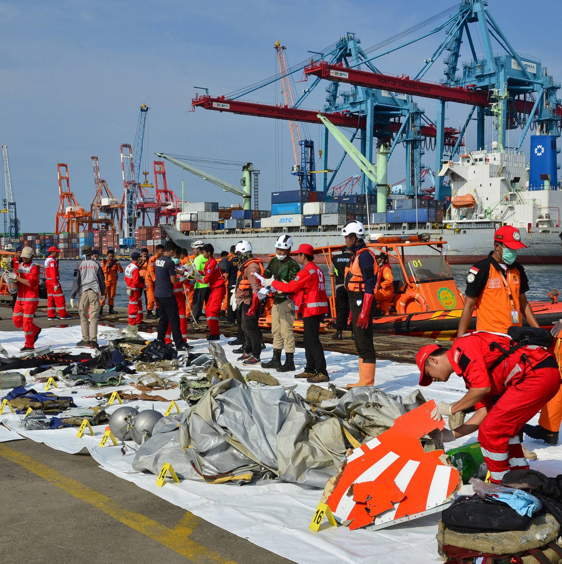 Rescue team members arrange Lion Air flight JT610 wreckage at Tanjung Priok port in Jakarta