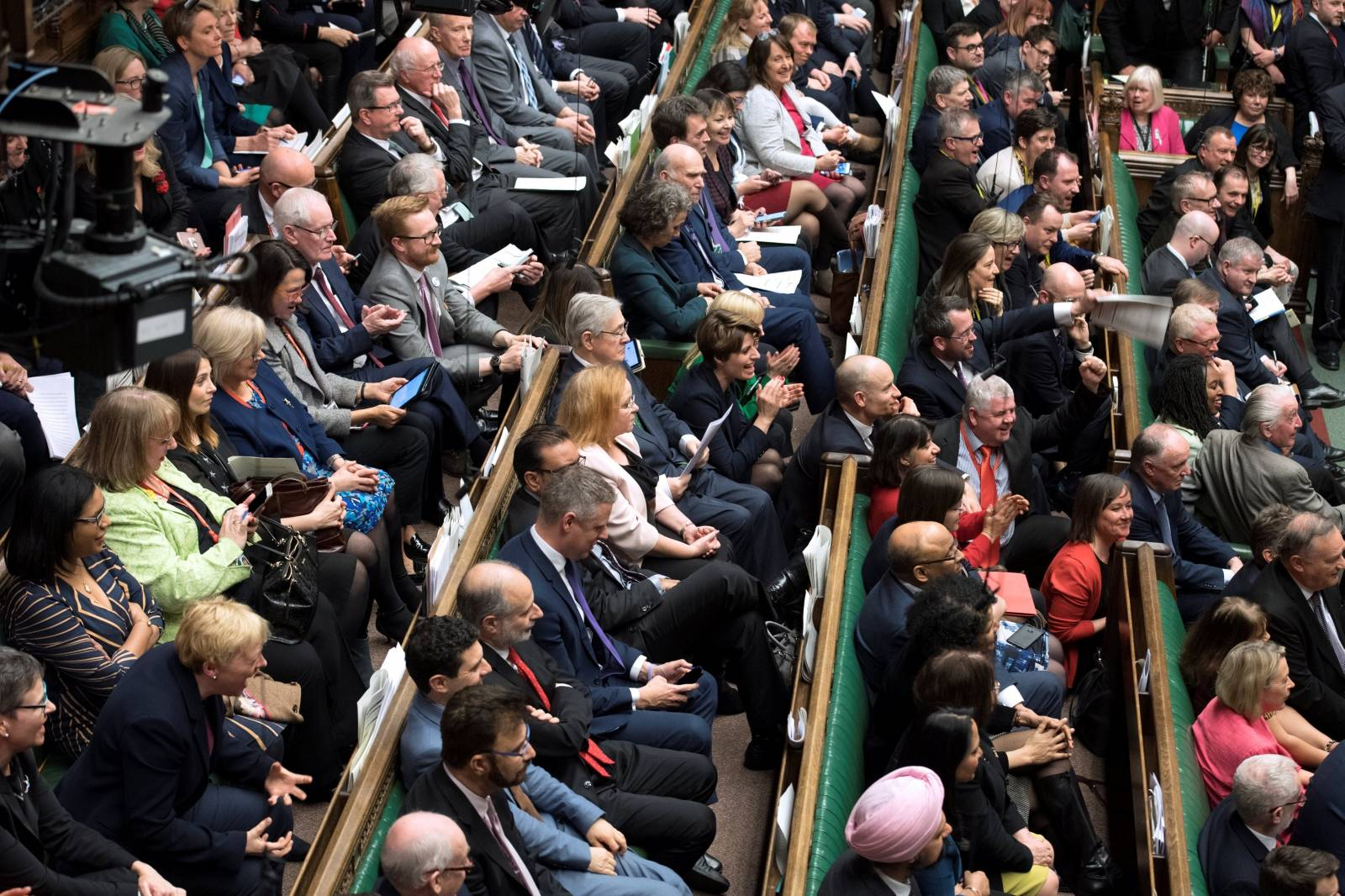 MPs react in Parliament following the vote on Brexit in London