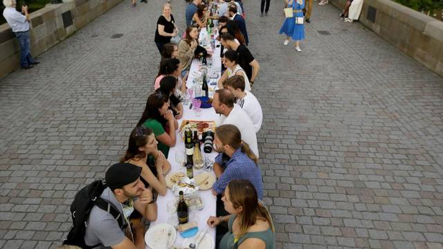 Residents dine at the medieval Charles Bridge in Prague