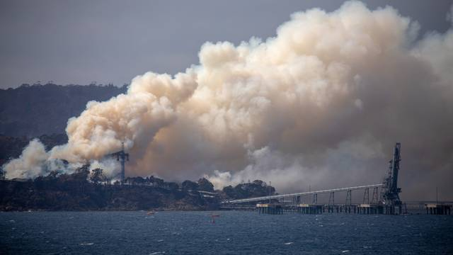 Smoke rises from the Eden Woodchip Mill, from a fire that has been blazing for days, in Eden