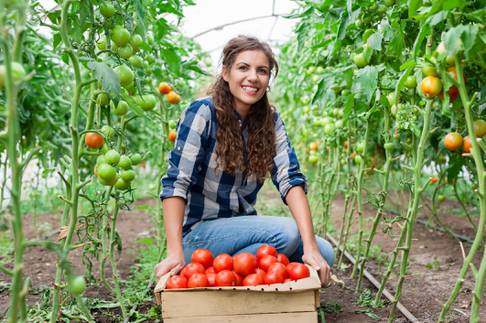 Young smiling agriculture woman worker