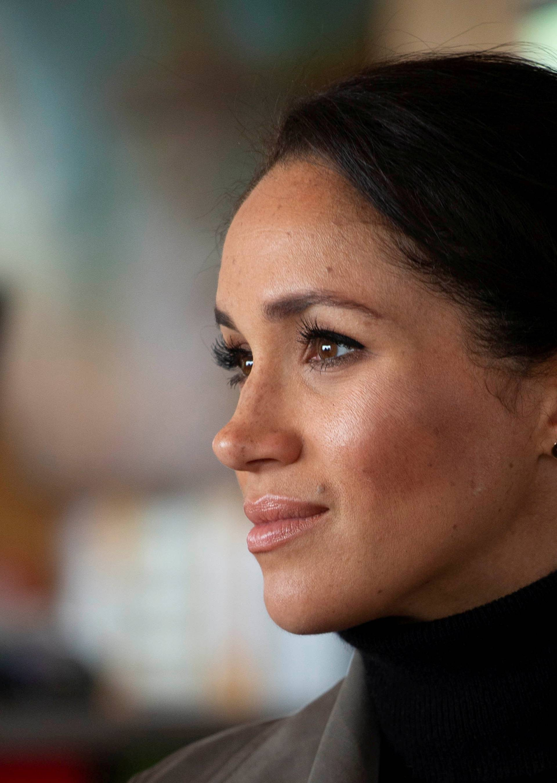 FILE PHOTO: Prince Harry, The Duke of Sussex with Meghan Markle the Duchess of Sussex meet young people from a number of mental health projects operating in New Zealand, at the Maranui Cafe in Wellington