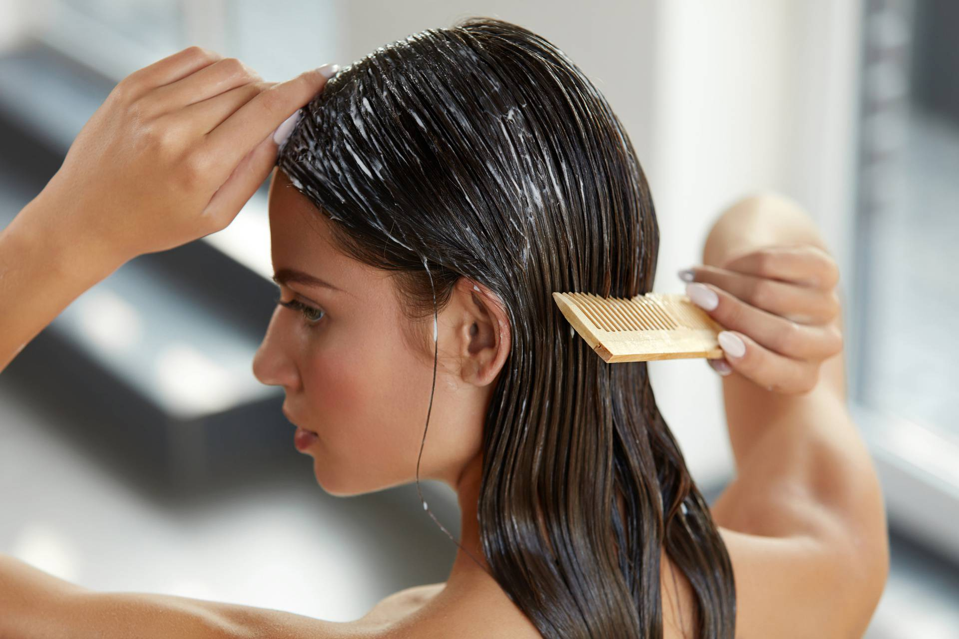 Beautiful Woman Putting Mask On Long Wet Hair. Hairbrushing