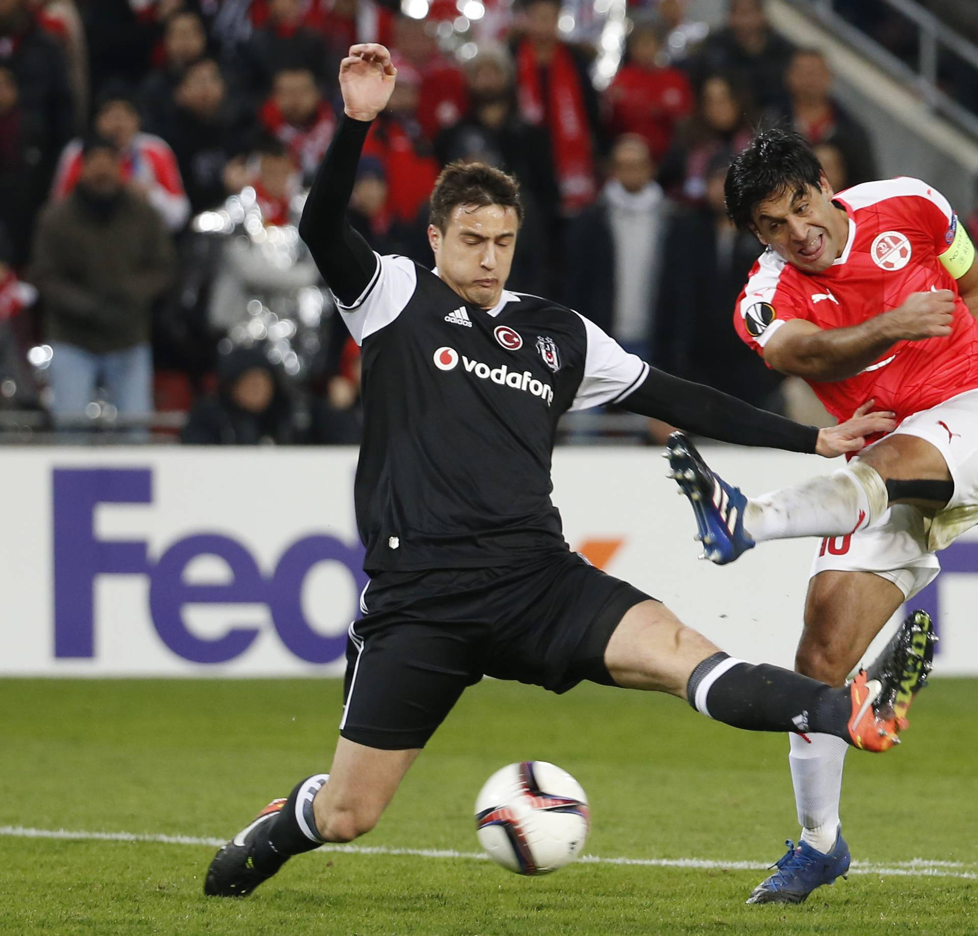 Hapoel Be'er-Sheva's Elianiv Barda in action with Besiktas' Matej Mitrovic