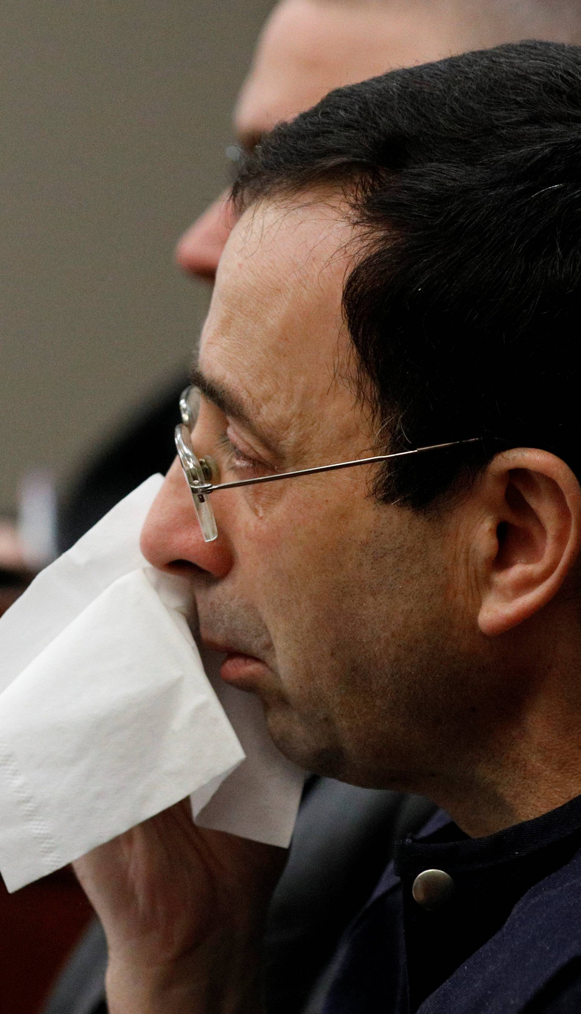 Larry Nassar, a former team USA Gymnastics doctor who pleaded guilty in November 2017 to sexual assault charges, sits in the courtroom during his sentencing hearing in Lansing, Michigan
