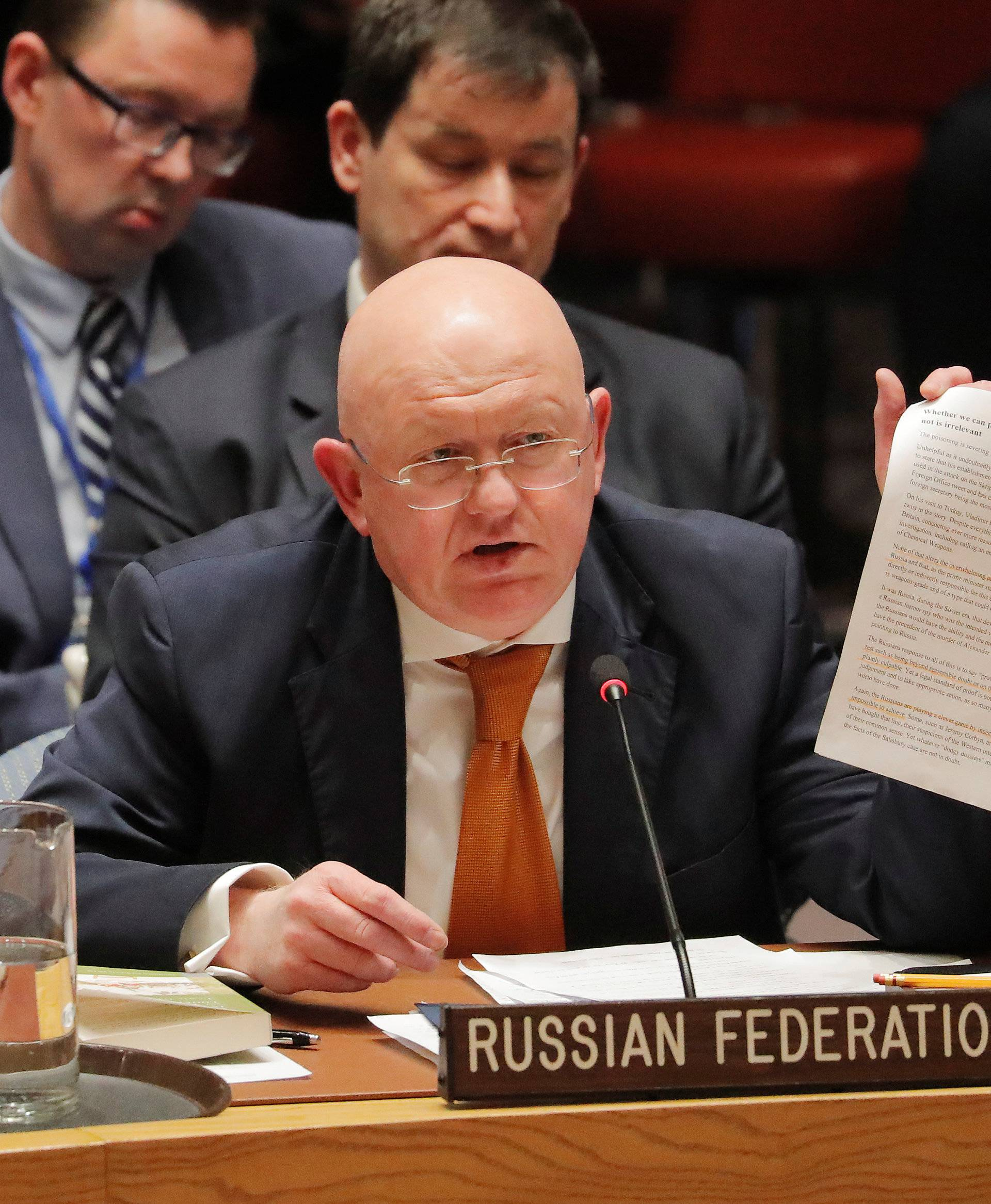 Russian Ambassador to the U.N. Vasily Nebenzya holds a paper up as he speaks regarding an incident in Salisbury, during a meeting of the U.N. Security Council at U.N. headquarters in New York