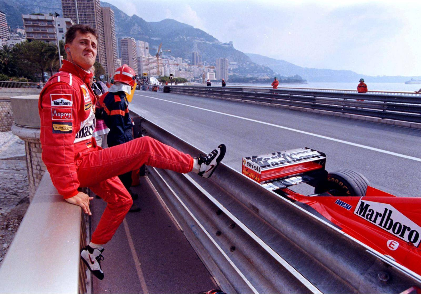 FILE PHOTO: Germany's Michael Schumacher poses next to his Ferrari during qualifying for the Monaco Grand Prix in Monte Carlo