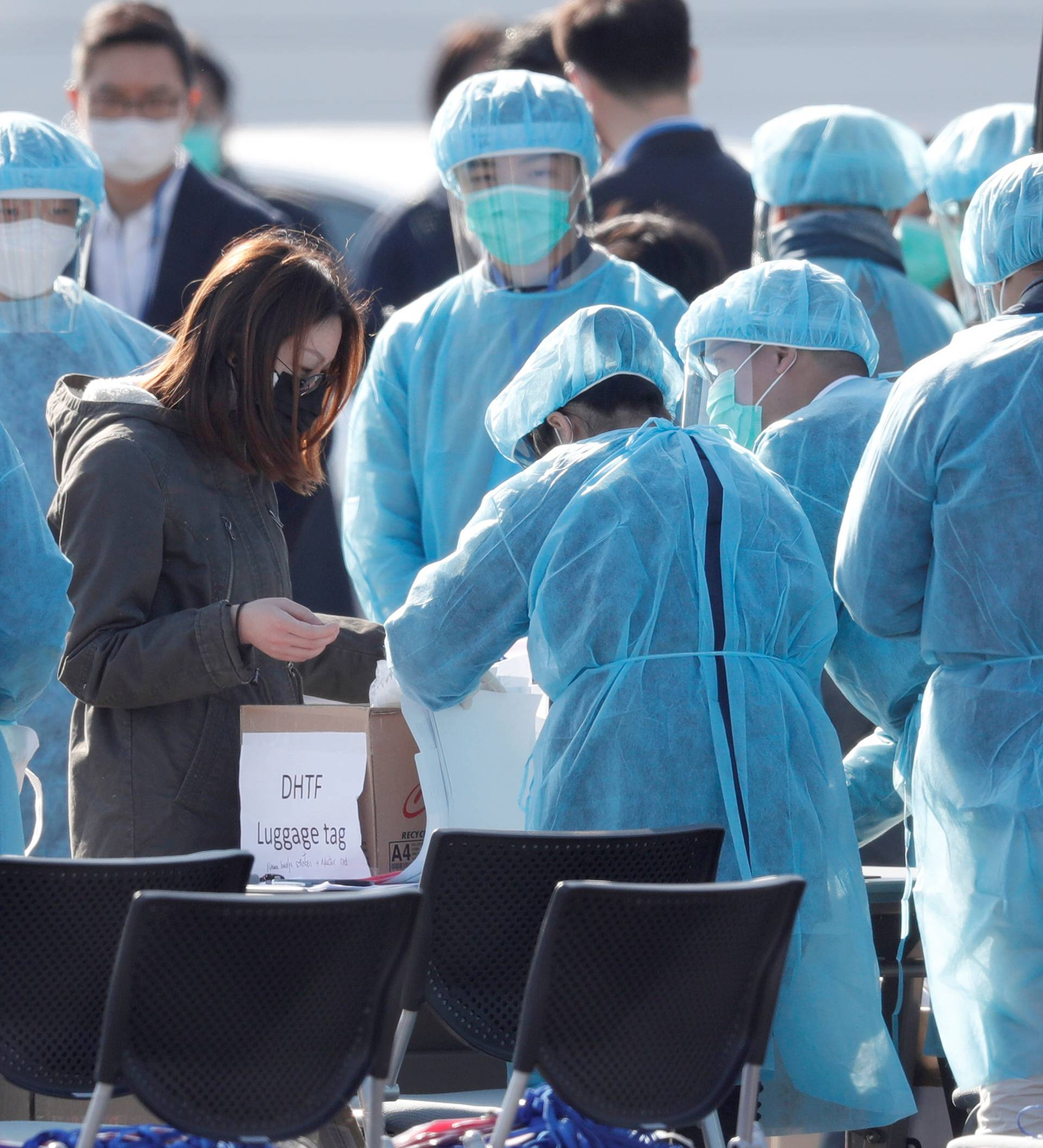 Passengers wearing masks leave cruise ship Diamond Princess at Daikoku Pier Cruise Terminal in Yokohama