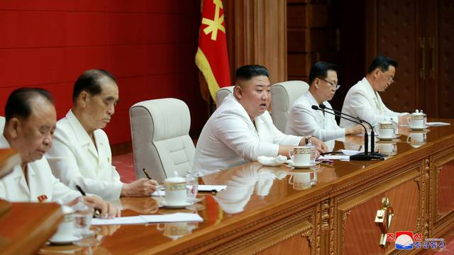 North Korean leader Kim Jong Un addresses a plenary meeting of the Central Committee of the Workers' Party of Korea in North Korea