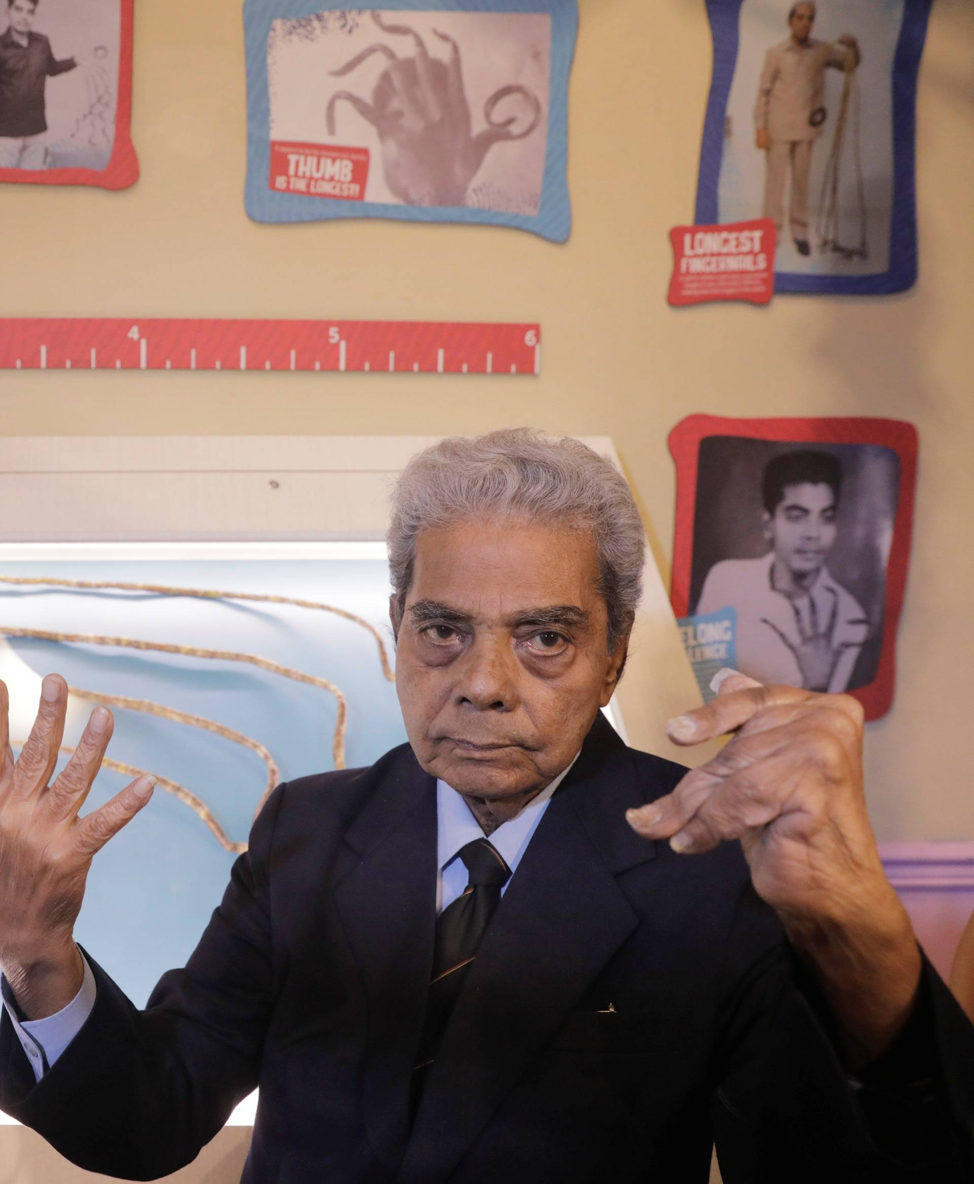 Shridhar Chillal of India displays his newly cut fingernails at an announcement that the five fingernails he grew for 66 years will be displayed in Ripley's Believe it or Not in New York