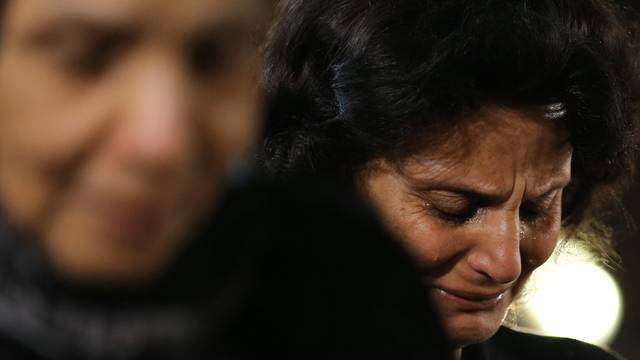 Relatives of the Christian victims of the crashed EgyptAir flight MS804 react and cry during an absentee funeral mass at the main Cathedral in Cairo