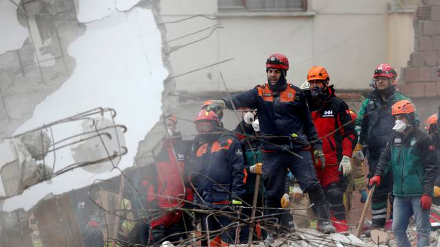Rescue workers are seen at the site of a collapsed residential building in the Kartal district, Istanbul