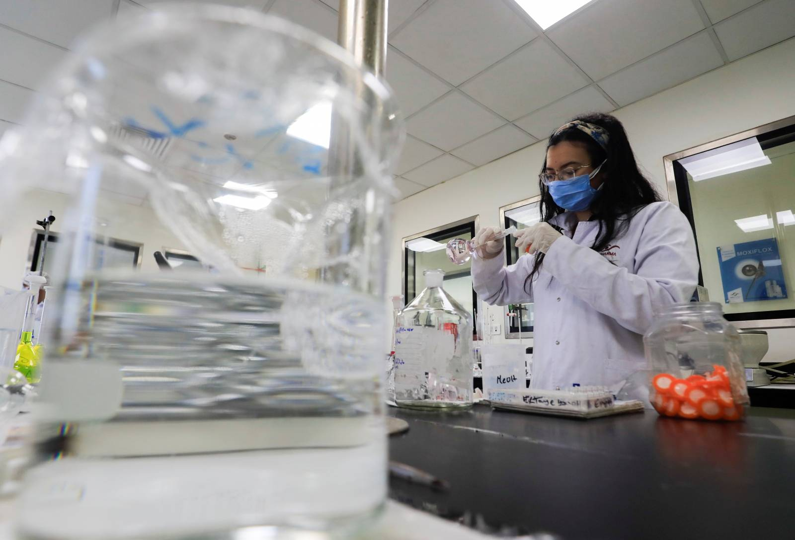 """A pharmacist doctor works on the basics of the raw materials for investigational of the coronavirus disease (COVID-19) treatment drug """"Remdesivir"""", in Ibn Sina laboratory, at Eva Pharma Facility in Cairo"""