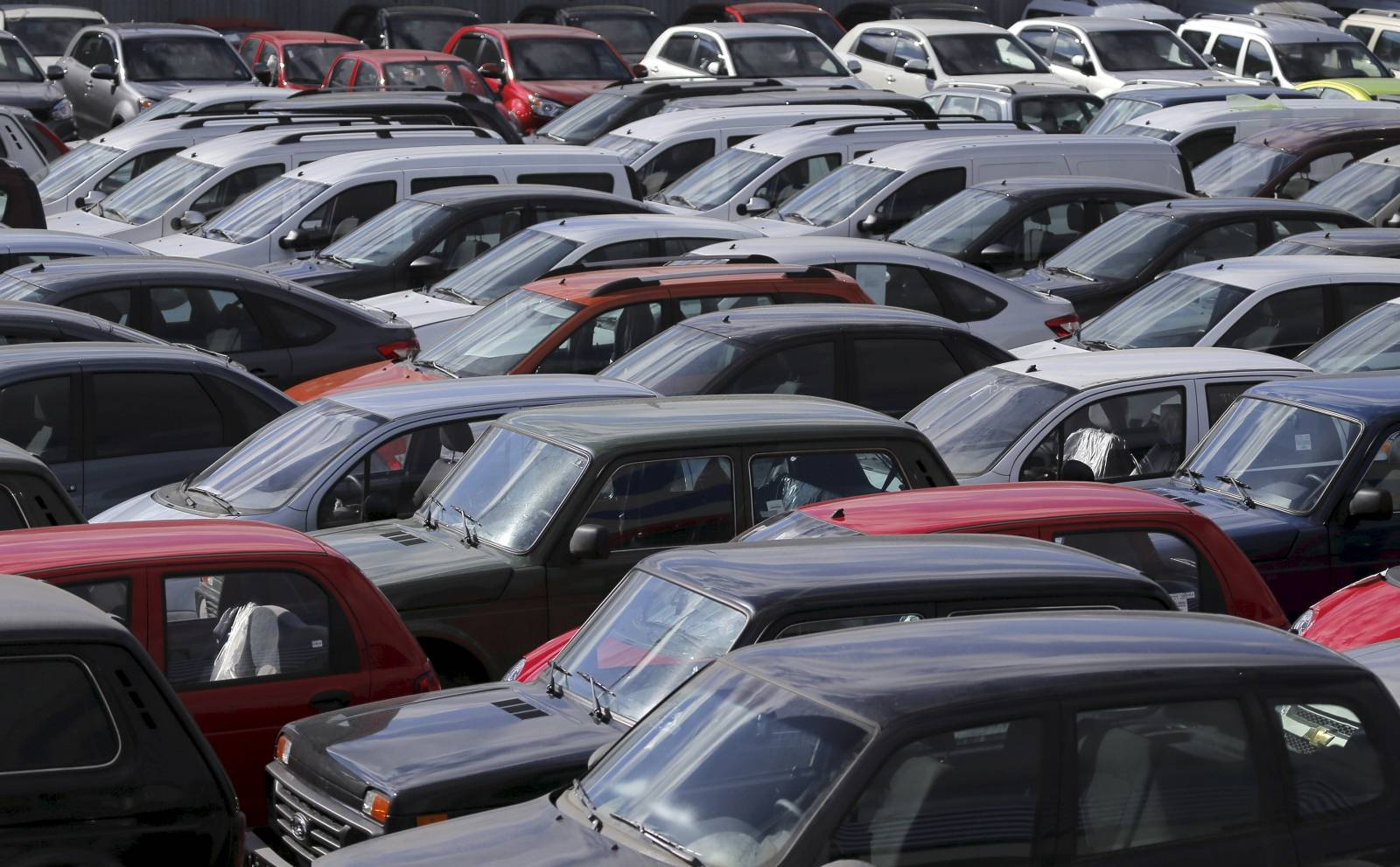 FILE PHOTO: Vehicles, including Lada cars produced by the Russian automobile maker Avtovaz, are parked on the premises of the 'AvtoGermes' dealership in Moscow