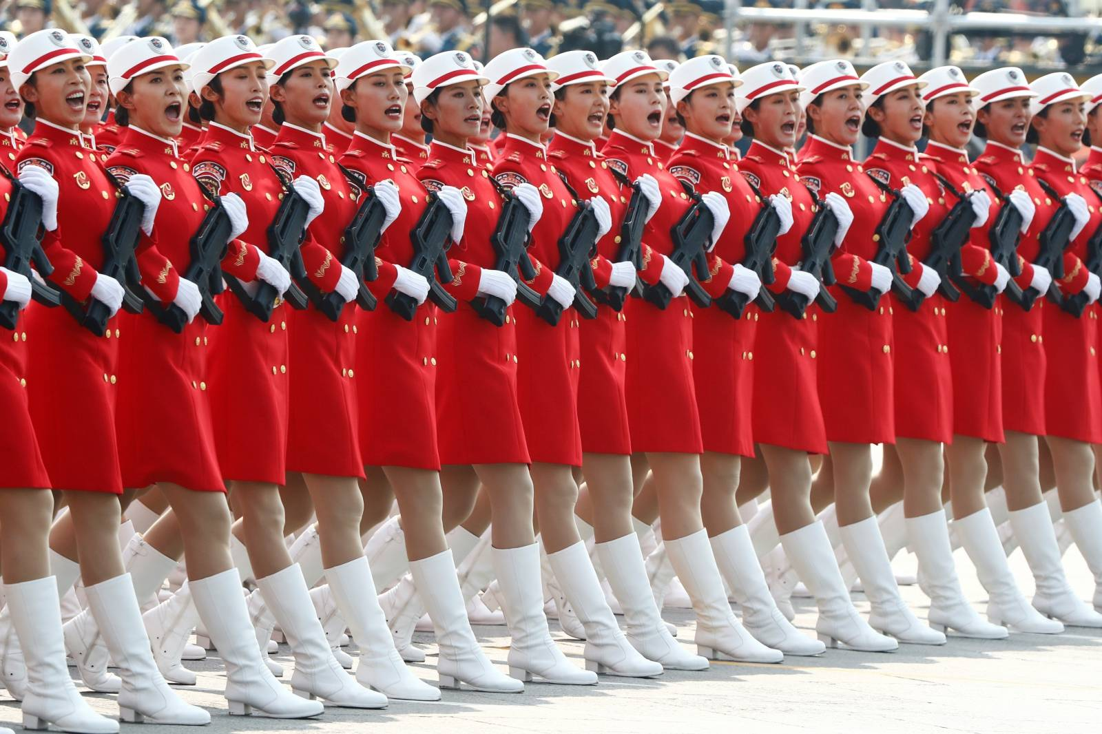 Militia members march in formation past Tiananmen Square during the military parade marking the 70th founding anniversary of People's Republic of China