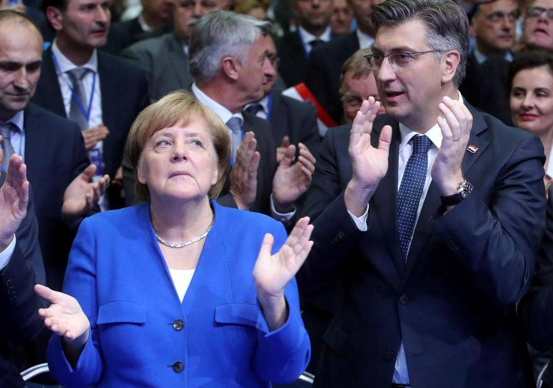 Croatia's Prime Minister Andrej Plenkovic, German Chancellor Angela Merkel and Manfred Weber of the European People's Party during EPP and the Croatian Democratic Union's campaign rally for the European Parliament elections in Zagreb