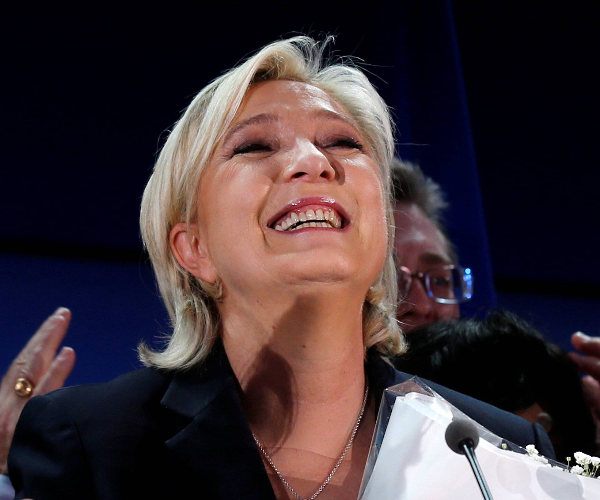Marine Le Pen, French National Front (FN) political party leader and candidate for French 2017 presidential election, celebrates after early results in the first round of 2017 French presidential election, in Henin-Beaumont