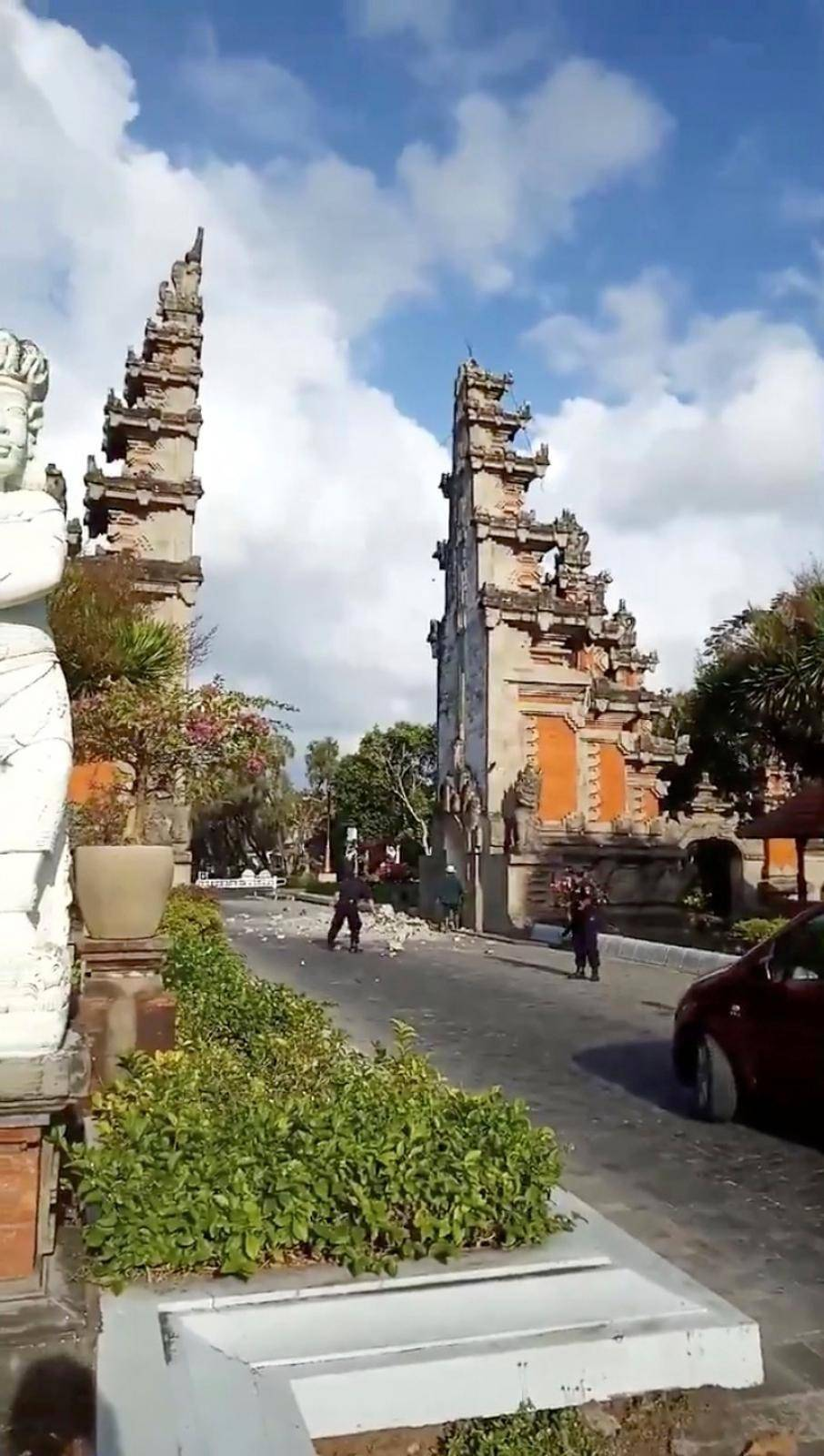 Debris from a partially collapsed gate blocks a road in Nusa Dua