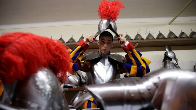 New recruit of the Vatican's elite Swiss Guard prepares for the swearing-in ceremony at the Vatican