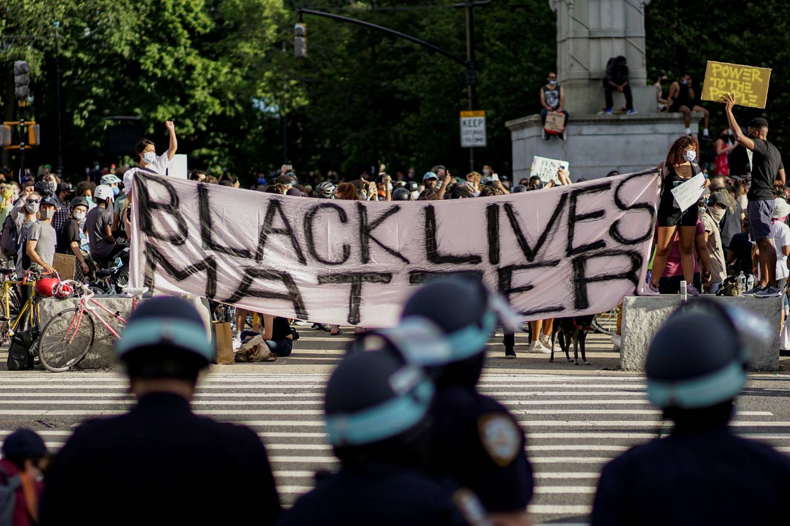 Demonstrators hold a Black Lives Matter banner during a protest against racial inequality in the aftermath of the death in Minneapolis police custody of George Floyd, at Grand Army Plaza in the Brooklyn borough of New York City
