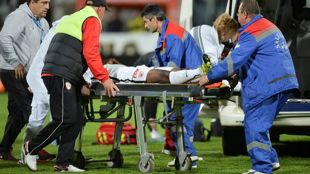 Dinamo Bucharest's Ekeng is transported to an ambulance after collapsing during a play-off match against Viitorul Constanta in Bucharest