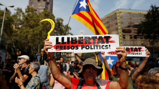 Demonstrators block a street next to Plaza de Catalunya during a protest after a verdict in a trial over a banned independence referendum, in Barcelon