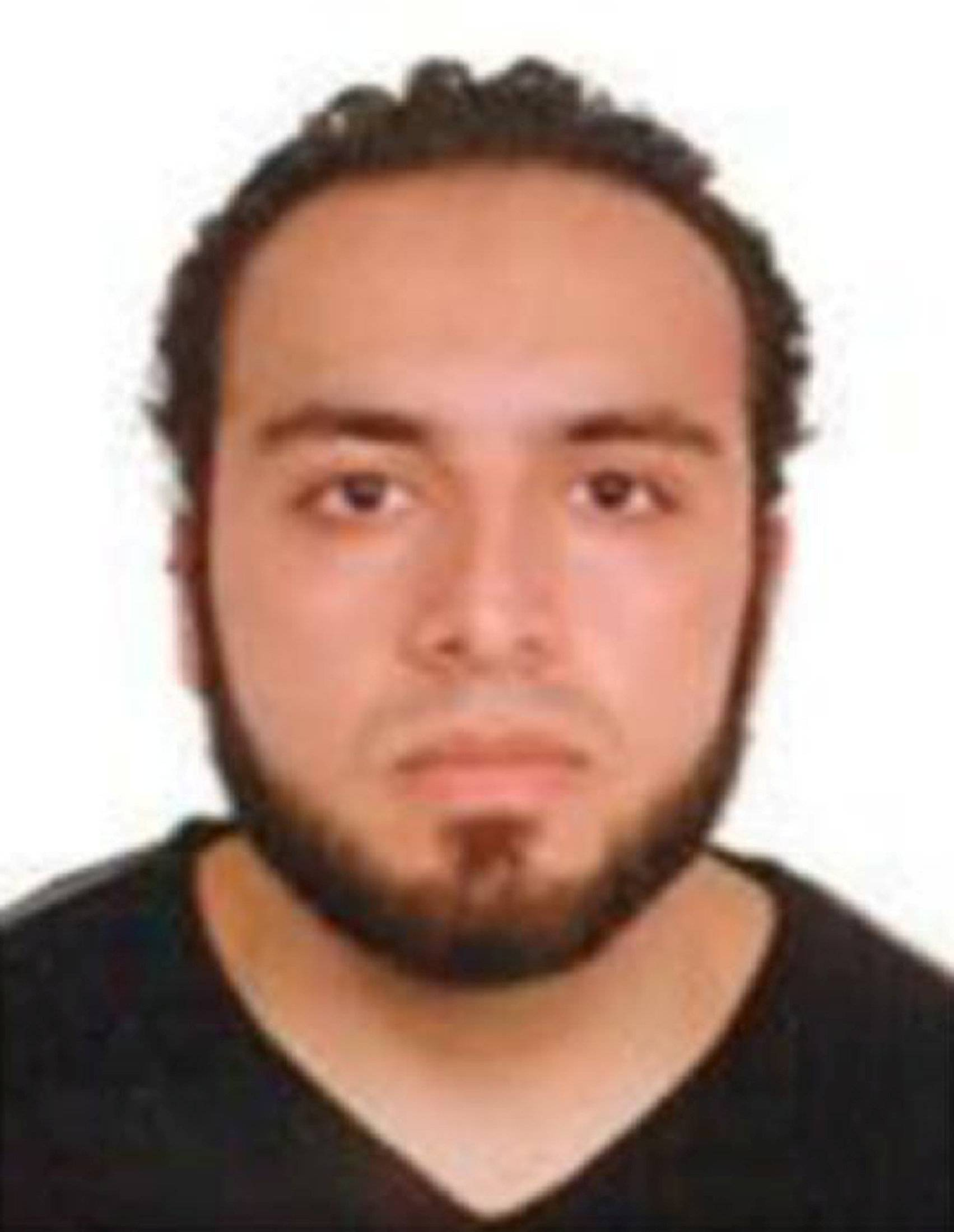 An image of Ahmad Khan Rahami, who is wanted for questioning in connection with an explosion in New York City, is seen in a a poster released by the Federal Bureau of Investigation