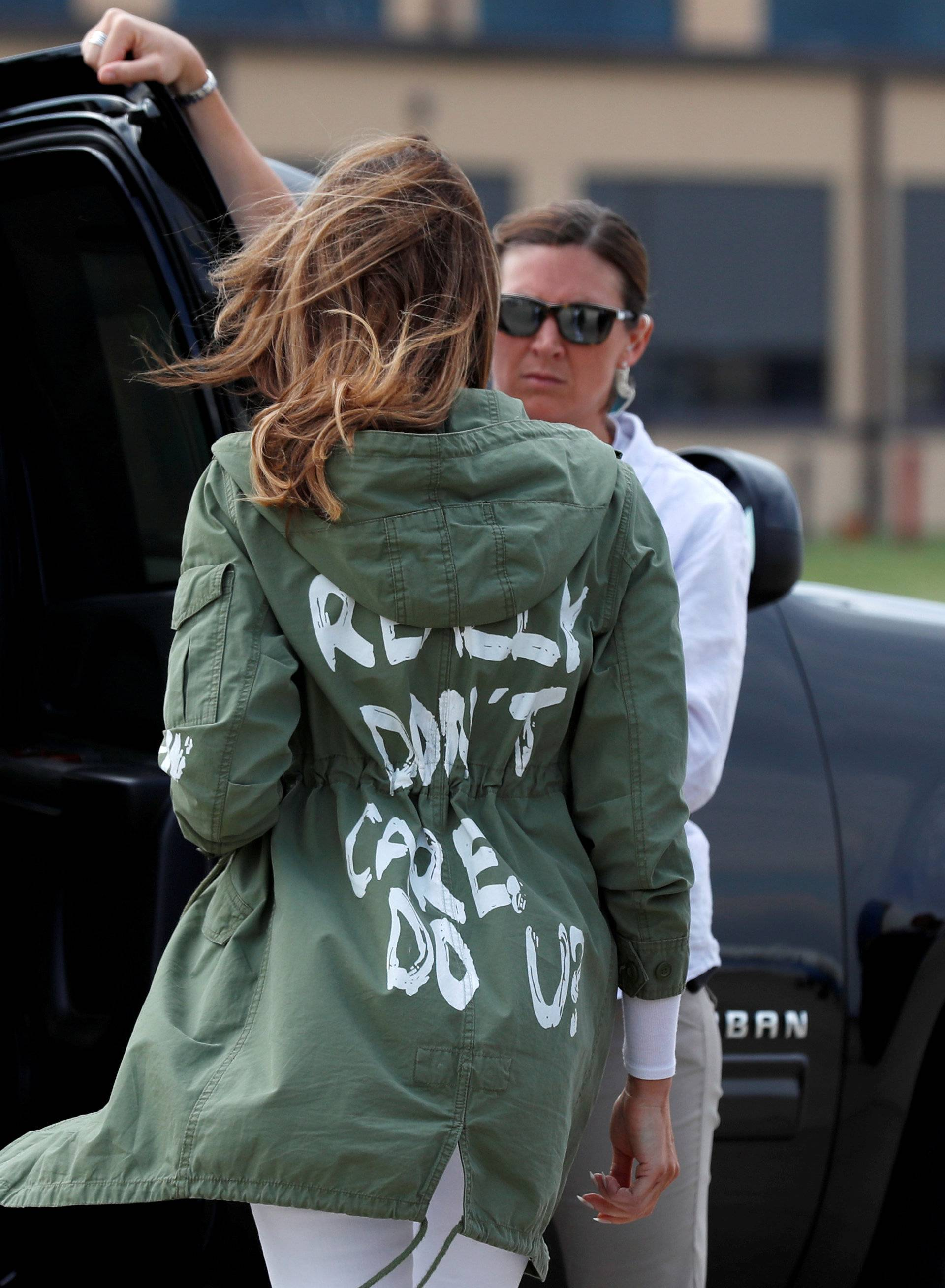 """U.S. first lady Melania Trump arrives back in Washington from Texas wearing """"I Don't Care. Do U?"""" jacket at Joint Base Andrews, Maryland"""