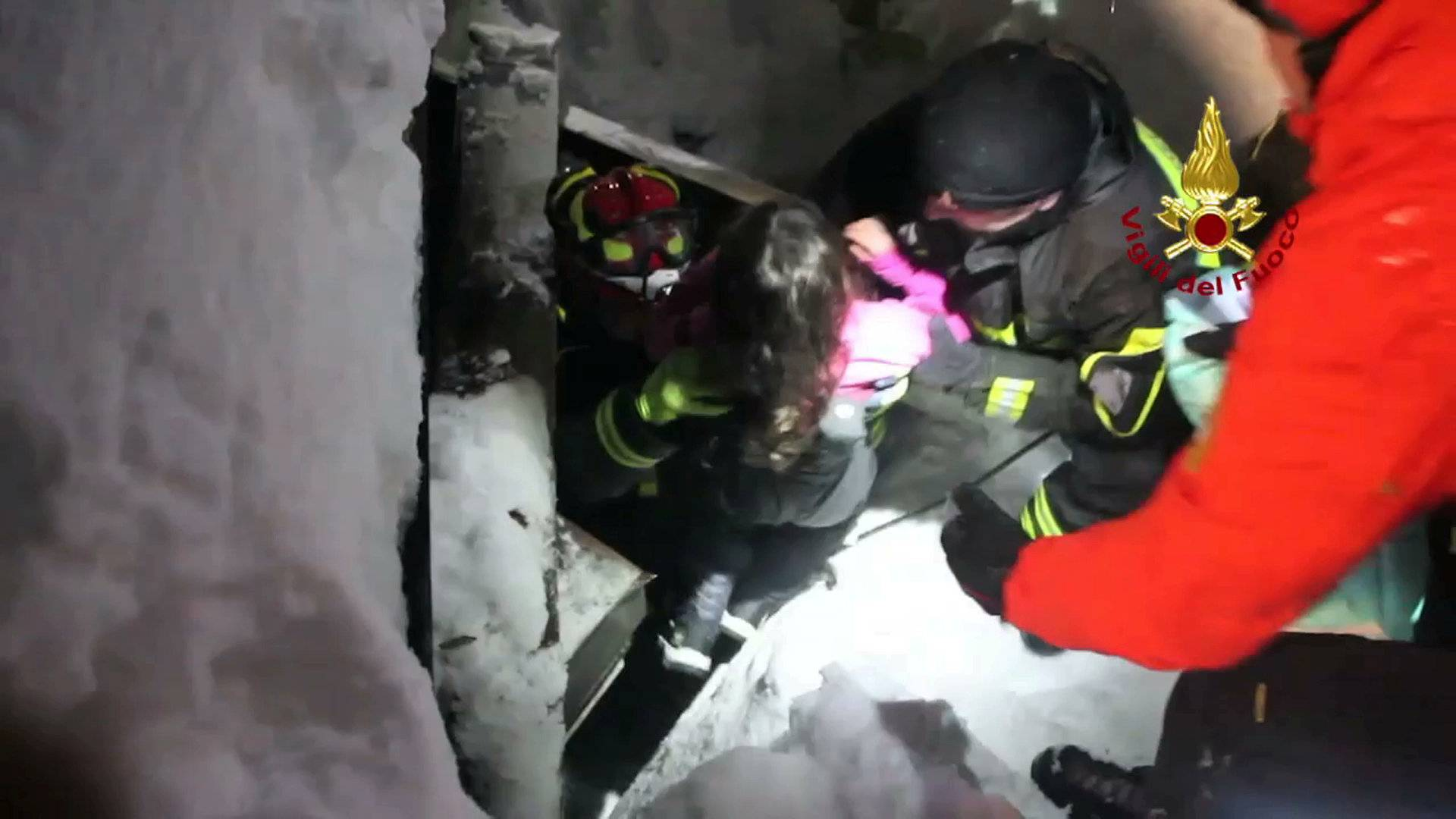 A still image taken from a video shows a survivor, rescued by Italian Firefighters, at the Hotel Rigopiano in Farindola, central Italy, which was hit by an avalanche
