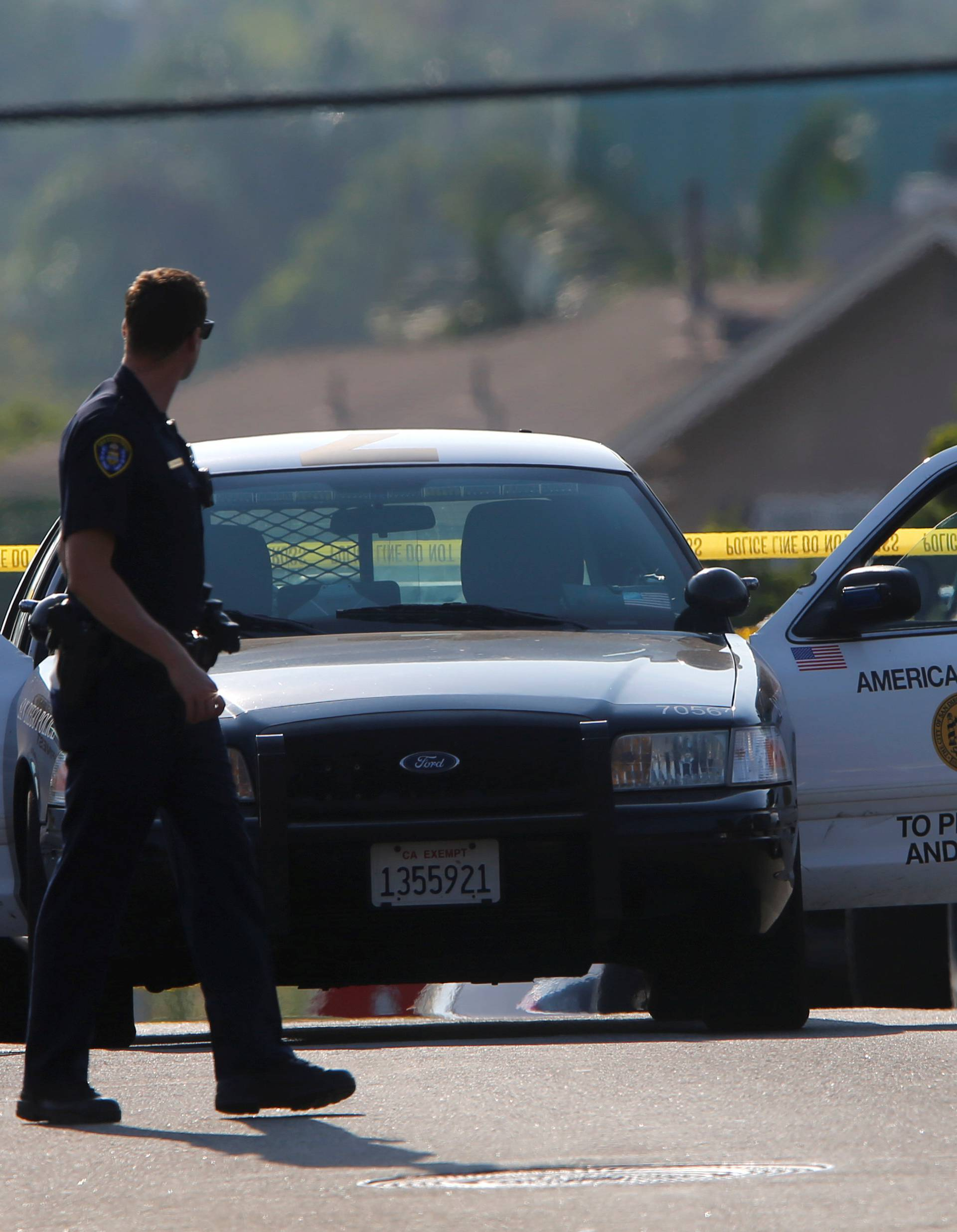 Police block off roads as they protect a crime scene and search for a second suspect after a San Diego police officer was fatally shot and another was wounded late on Thursday, in San Diego